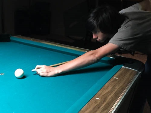 Andrew (19) shooting pool