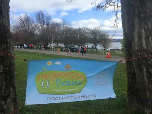 Magnuson Series sign with starting line and Lake Washington in the background
