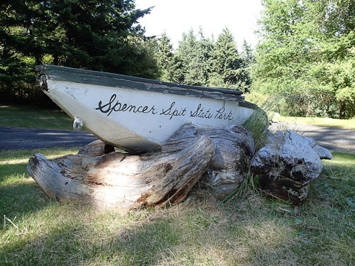Spencer Spit State Park entrance sign (name on a wooden boat)