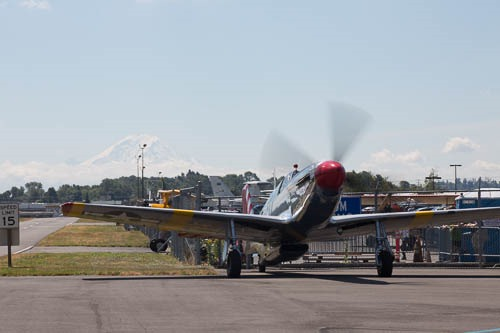 TP-51C Mustang warms up, with Mount Rainier in the background.