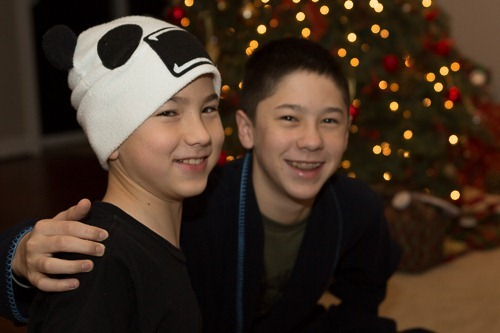 Michael and Andrew in front of the Christmas tree