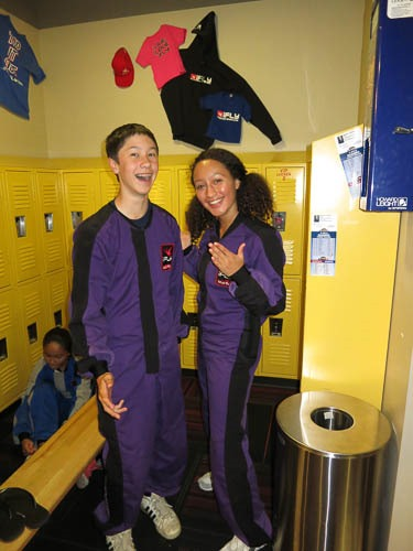Andrew and Maddi in purple jumpsuits