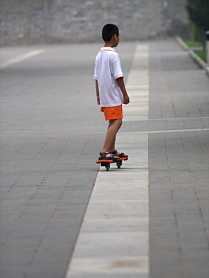 Boy on a jointed skateboard.