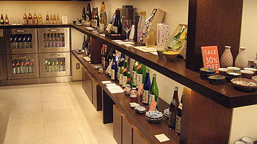 Shelves of sakeware and sake at Fukumitsuya