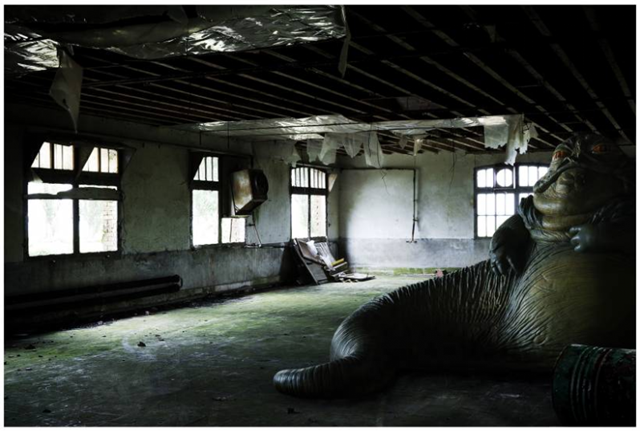 Image by Cedric Delsaux of Jabba the Hutt in a worn-out building.