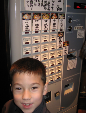 Michael (8) in front of the order machine Tetsugama Ramen.