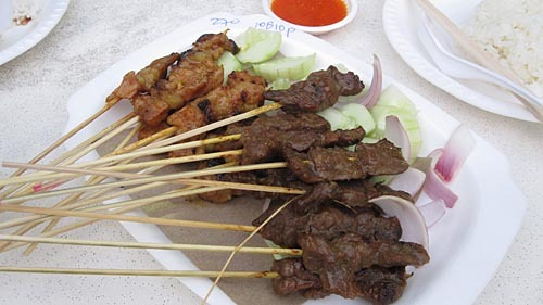 Plate of skewered pork and beef satays.