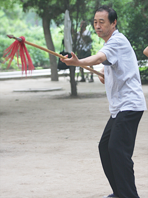 Man practicing with a Chinese spear.