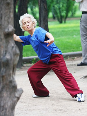 Older woman doing taiqi.