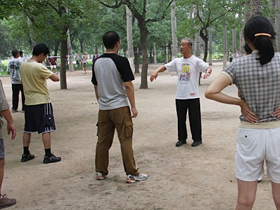 Taiqi instructor facing a row of students.