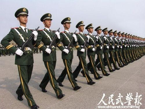 A very neat row of Chinese soldiers marching.