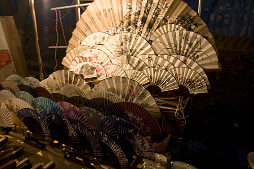 Paper fans on display at the night market.