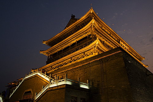 The Drum Tower illuminated at night.