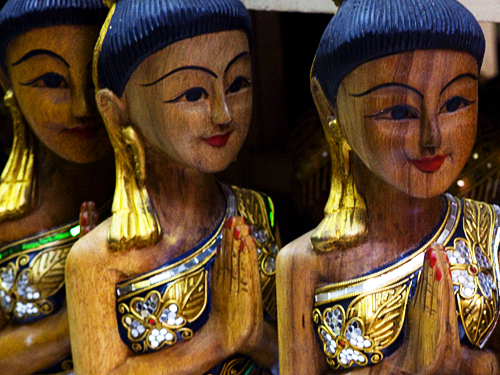 "Wooden statues of a Thai women ""wai-ing"""