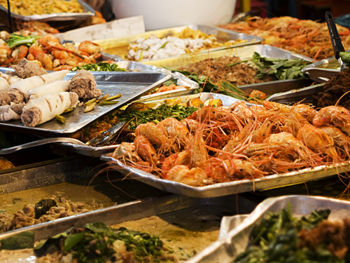 Trays of seafood at a food vendor