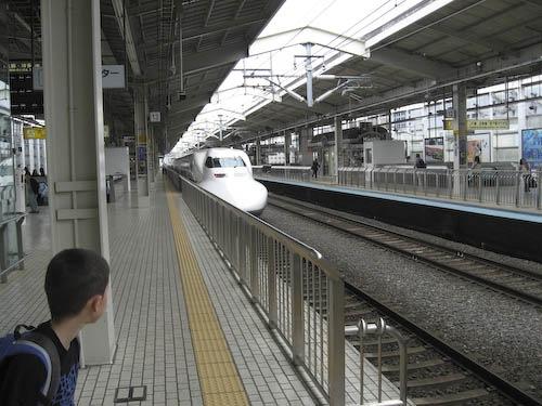 The Nozomi Shinkansen coming into the station.