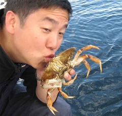 Tony kissing the crab before returning it to the sea.