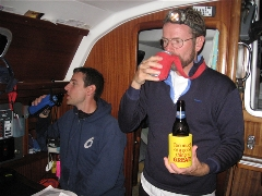 Mike and Dan showing how to drink beer on a boat.