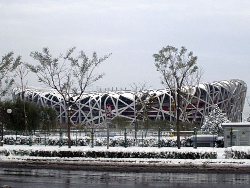 The Bird's Nest Stadium under snow.