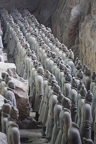 Rows and rows of terracotta soliders, viewed from the side.