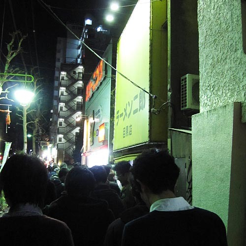 The line outside Ramen Jirou (the yellow sign).
