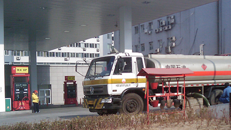 Gas station in Beijing with paltry fire fighting gear next to a tanker truck.