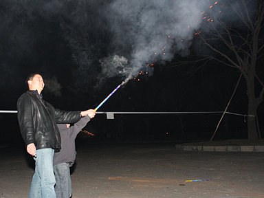 Me helping Michael fire a Roman candle.