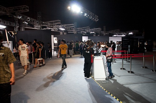 The show floor with mini studios on the left and printing station on the right.