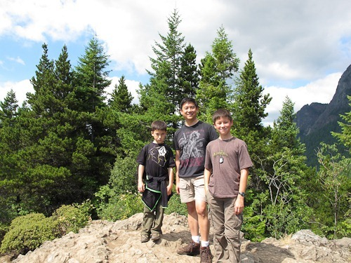 Michael, Tony, and Andrew standing on the top of Little Si