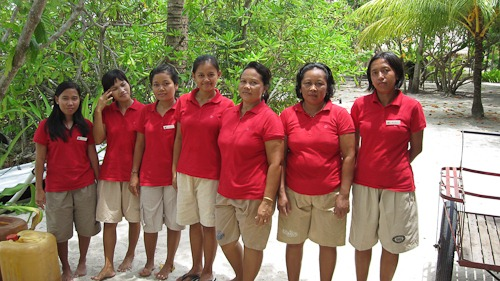 Seven lovely staff ladies in red polos and khaki shorts
