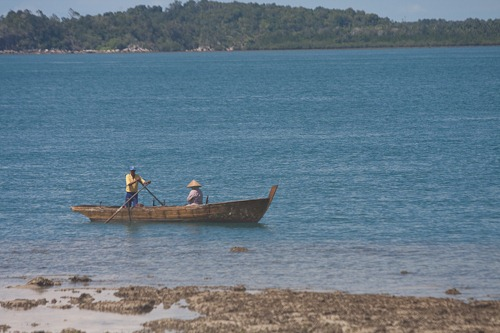 Traditional Indonesian row boat with two people