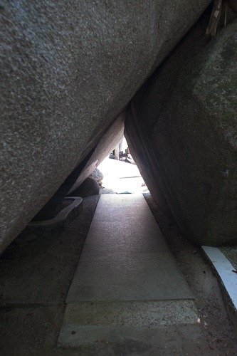 Passageway under two huge boulders.