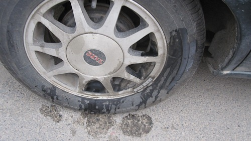 Unprotected tire with pee marks.