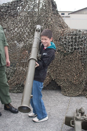 Andrew (13) holding a bazooka that is too heavy for him