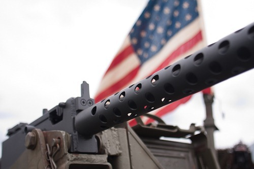 .30 caliber machine gun with US flag behind