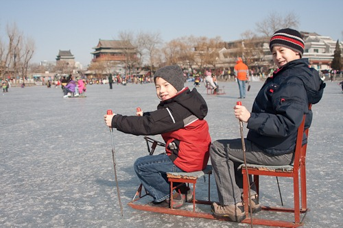 Michael and Andrew on an ice chair in Houhai. The Drum and Bell Towers are visible in the background.