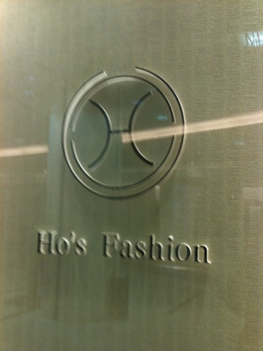 "Shop sign saying ""Ho's Fashion"""